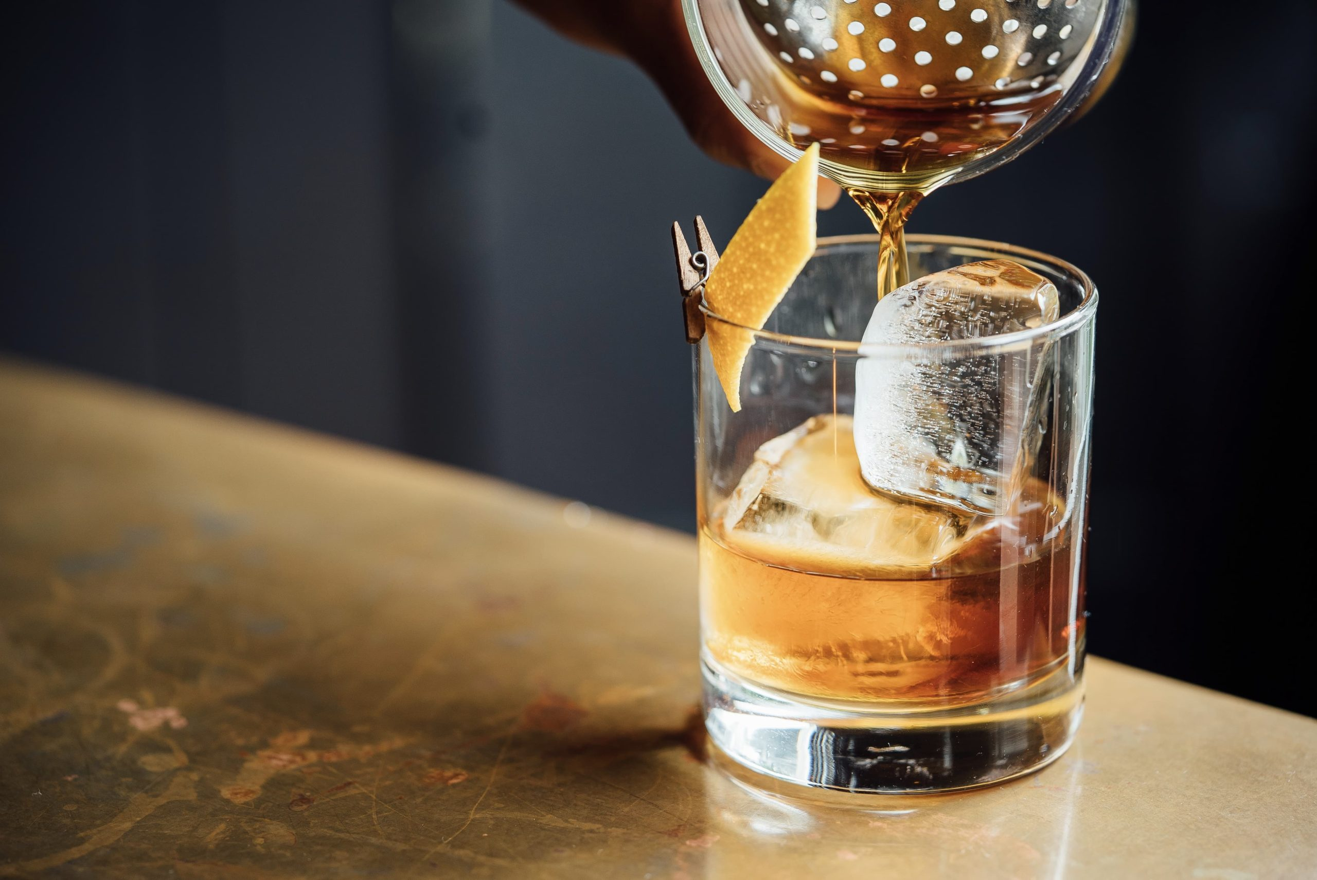 Pouring cocktail into glass