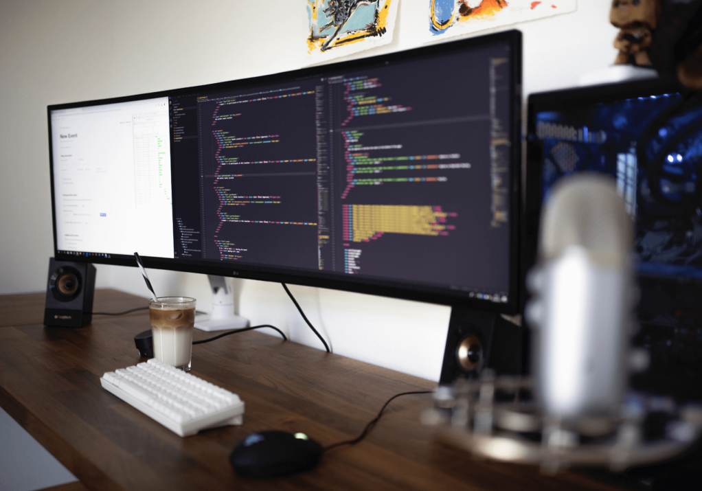 Large computer screen with coding