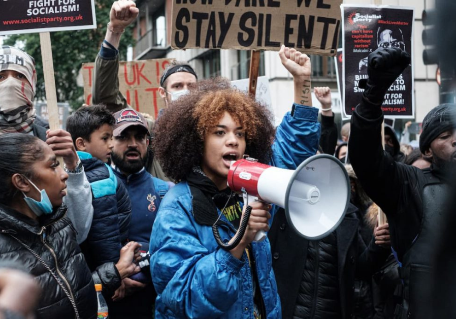 Woman at protest with microphone