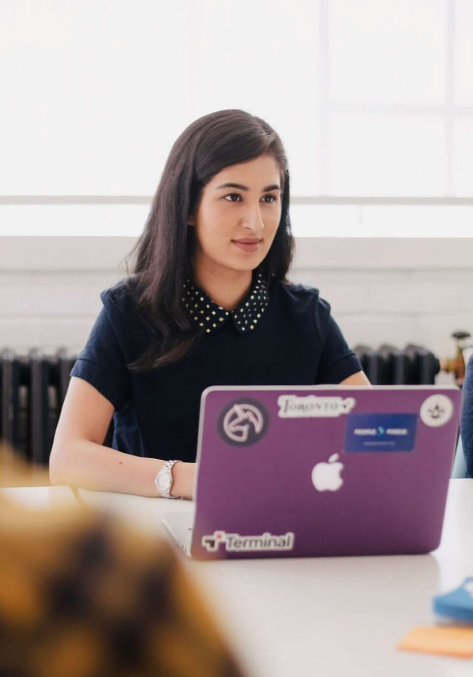 Woman on laptop at meeting